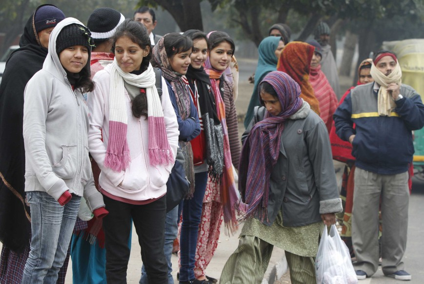 Chandigarh: People covered with heavy woolens waiting for a bus as the chill caught up the residents on Tuesday in Sector 10 of Chandigarh. LokMarg.com photo by Rajnish Katyal